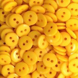 Boutons jaune orangé résine 1cm (lot de 100)