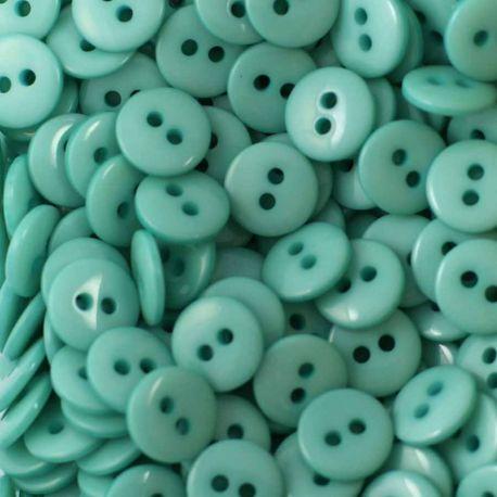 Boutons turquoise clair résine 1cm (lot de 100)